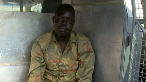 Garang Aguern, a father from Mount Druitt, in the back of a police wagon.