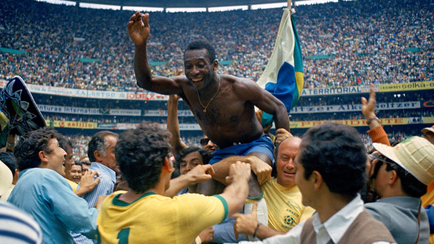 Pele is hoisted on shoulders of his teammates after Brazil won the World Cup final against Italy in 1970