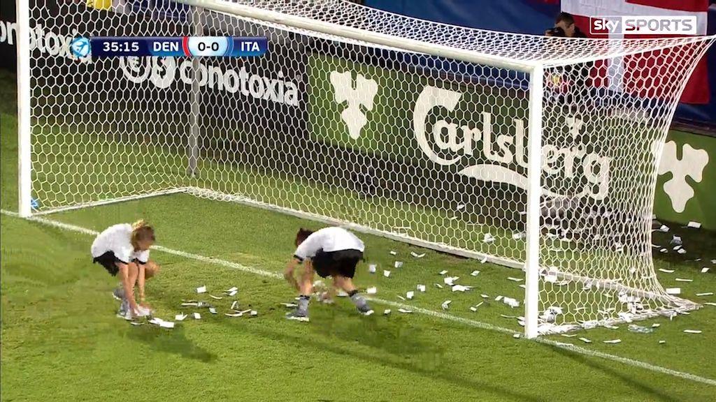 Teenage goalkeeper has fake money thrown at him