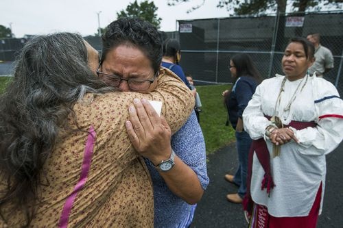 In this Monday, Aug. 7, 2017 file photo, Millie Friday, a descendent of Little Plume, a Native American student who was taken from his family and forced to go to boarding school, is comforted by Barbara Andrews-Christy of Circle Legacy Center, during a gathering on the grounds of the Carlisle Barracks, in Carlisle, Pa. (AP)