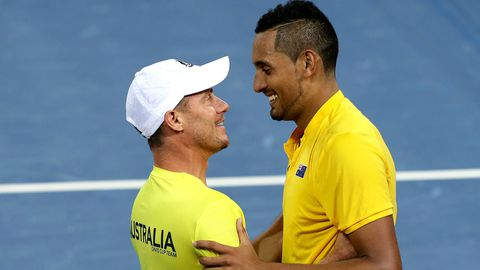 Nick Kyrgios and Lleyton Hewitt embrace