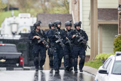 More than 80 police officers, as well as FBI agents and highway patrol troopers, are involved in the search. (AAP)