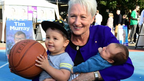 Kerryn Phelps smiles with her grandchildren on election day in Sydney.