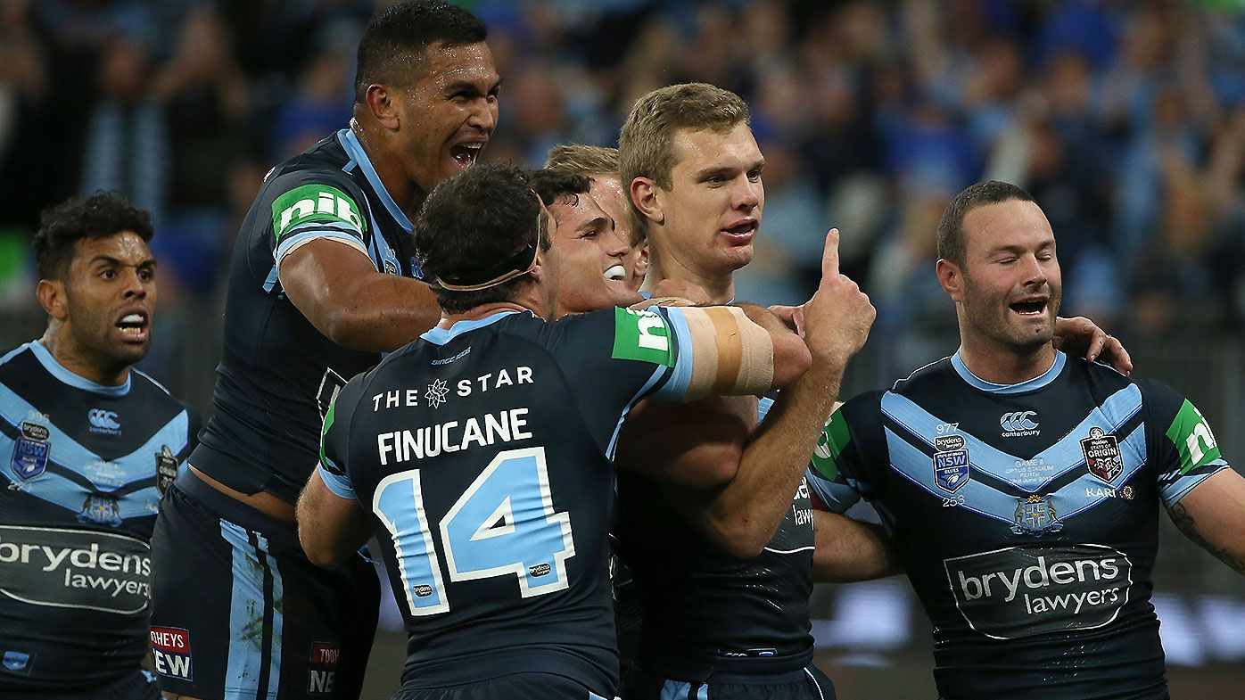NSW celebrate a Tom Trbojevic try.