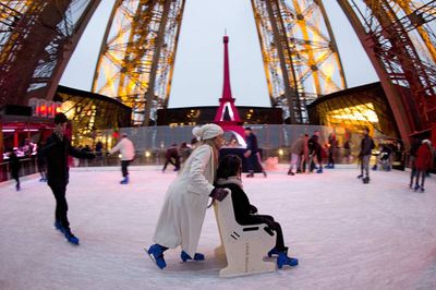 Meanwhile, on the tower's first floor, a skating rink keeps climbers busy. (Kenzo Tribouillard/AFP/Getty)