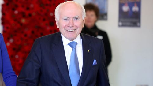 Former prime minister John Howard has urged Liberal voters to stay loyal in the battle for Wentworth.