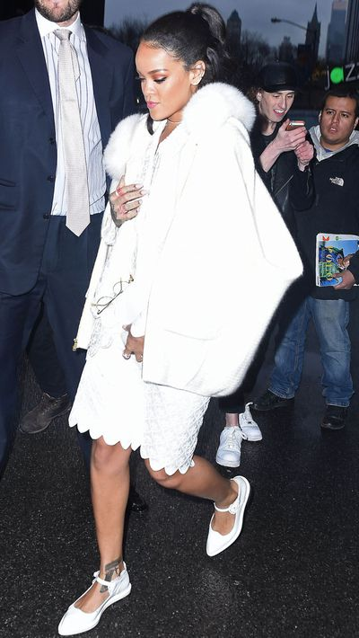 This all-white look is demure by Rihanna's standards