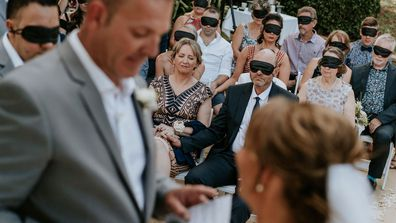 Wedding guests have donned blindfolds so they could experience a blind bride's wedding alongside Steph Agnew.