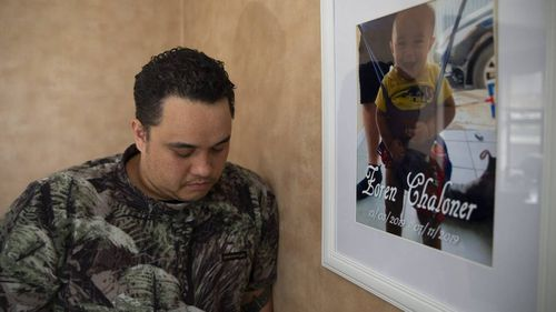 David Chaloner with a photo of his son Zoren Ngatokorua Israel Chaloner.