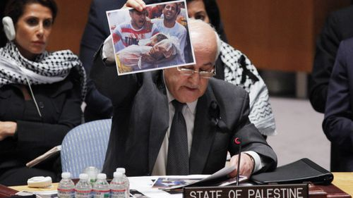 Palestinian envoy to UN holds up photos of slain children in ceasefire plea