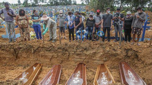 Coronavirus fatalities are buried in mass graves in Manaus, Brazil.