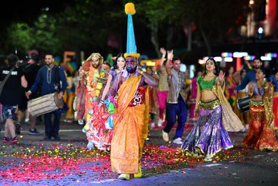 This marcher shows off his zany clown outfit. (AAP)
