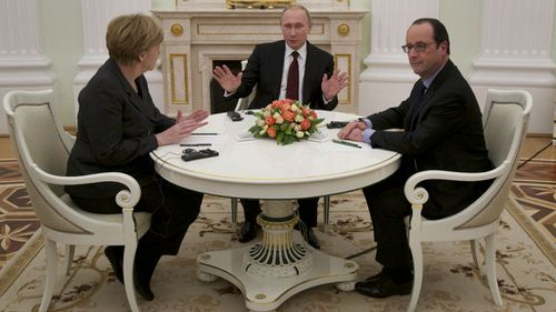 Russian President Vladimir Putin, centre, gestures during his talks with German Chancellor Angela Merkel, left, and French President Francois Hollande in Moscow, (AAP)