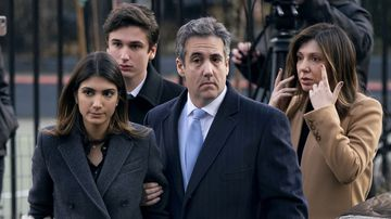 Donald Trump's lawyer Michael Cohen arrives with his family at court for sentencing.