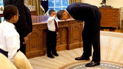 When Jacob Philadelphia asked the president if his hair was like his, Obama bowed down to let him feel.