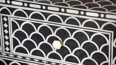The black and white patterned chest of drawers added a unique element to the room.