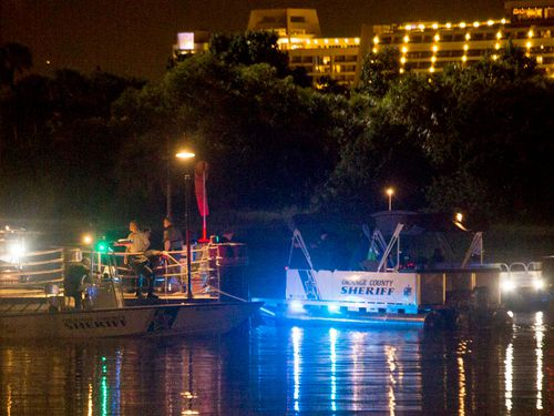 Search crews work through the night trying to locate the alligator that snatched a boy at the shore. (AAP)