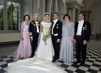 Princess Victoria of Sweden and Prince Daniel, Duke of Vastergotland pose with their parents.