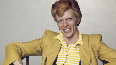 <p>English singer, musician and actor David Bowie with dyed red hair and a yellow suit, circa 1974. (Getty)</p>