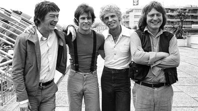 "British actor John Hurt, from left, American actor Brad Davis, author Billy Hayes, and British director Alan Parker appear in Cannes, France for the screening of their film ""Midnight Express"" at the 31st International Film Festival on May, 18, 1978"
