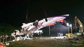 """<p _tmplitem=""""1"""">At least 25 people were killed yesterday when a passenger plane operated by TransAsia Airways clipped an overpass soon after take-off and plunged into a river in Taiwan, the airline's second crash in seven months.</p> <p _tmplitem=""""1"""">The rescue operation continued into the night, with a crane lifting the rear and central sections of the plane from the water, with one body retrieved from inside. (AAP)</p>"""