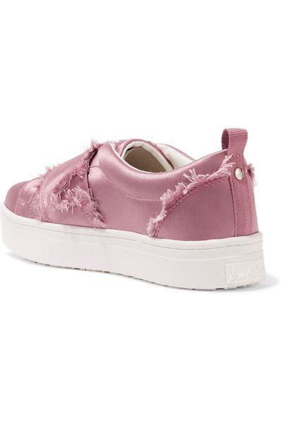 "<a href=""https://www.net-a-porter.com/au/en/product/890097/sam_edelman/levine-frayed-satin-slip-on-sneakers"" target=""_blank"">Sam Edelman Levine Sneakers, $137.</a><br>"