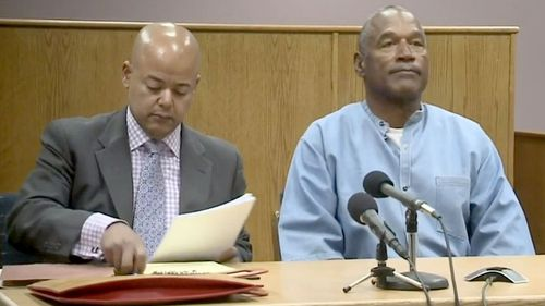OJ Simpson and his lawyer appear via videolink. (Twitter)
