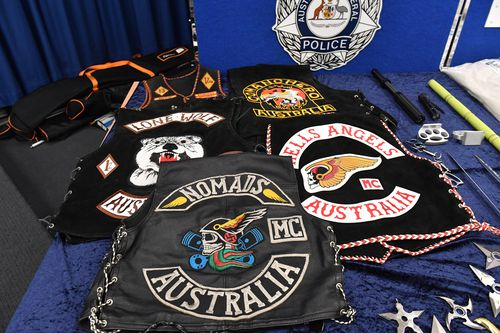 Seized bikie vests are seen at a press conference at Australian Federal Police (AFP) headquarters in Sydney. (AAP)