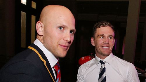 Gary Ablett (L) of the Suns congratulates Joel Selwood of the Cats on being announced in the All Australian Team Announcement. (Getty)