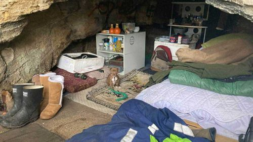 The cave that is home to Awhi and a dog he is looking after – Soxs.