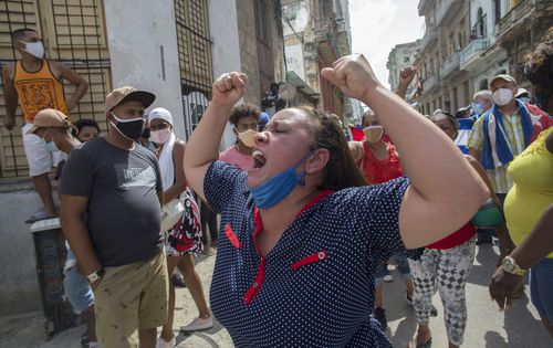 A woman shouts during a an anti-government protest in Havana, Cuba, Sunday, July 11, 2021. (AP Photo/Ismael Francisco)