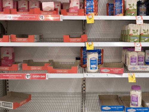 Depleted shelves of flour at the Coles supermarket in Woy Woy, NSW.