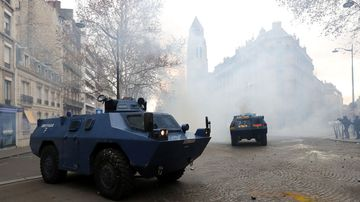 A dozen tanks rolled through the streets of the capital, a show of force the military hoped would keep protestors back.