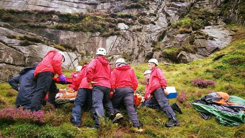 An Irish man has been rescued after being hit by a falling sheep while hiking near Hares Gap, Northern Ireland.