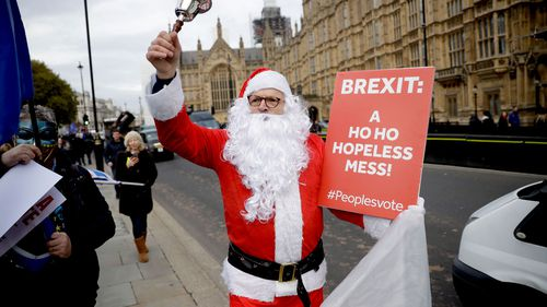 A demonstrator dresses as Santa Claus to protest Brexit outside London's Houses of Parliament.