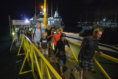 Overnight the last few hundreds of tourists managed to reach Bali from the Gili Islands. Picture: AAP.