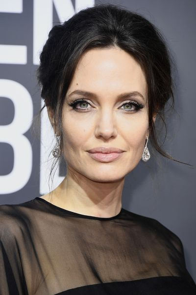 Angelina Jolie has kept her make-up and hair simple and eyes dramatic. These cat eyes are everything.