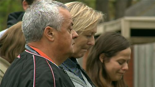 Peter and Donna pay their respects with family members.