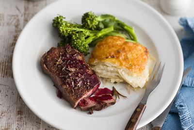Peppered steak with red wine jus and creamy potato bake
