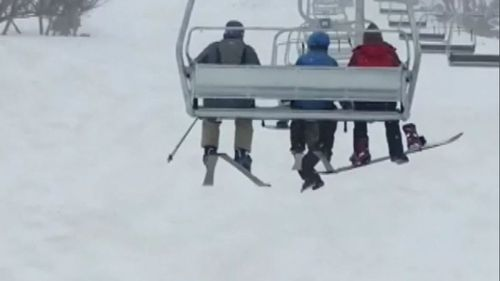 A snowboarder has been taken to hospital after falling several metres from a chairlift at New South Wales' Perisher Ski Resort.