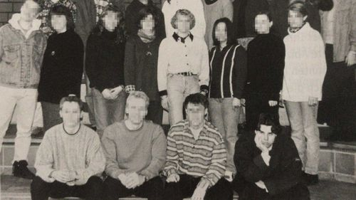 Tobias Rathjen, seen in the bottom corner of this high school photo, subscribed to QAnon, Nazi and incel ideologies.