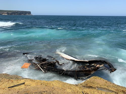 The charred remains of the cruiser are washing ashore along the Sydney coastline.