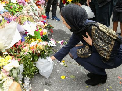 Jacinda Ardern lays a wreath at a Wellington mosque