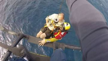 Two fisherman were winched to safety after their boat sank 12kms off Sydney's coast.