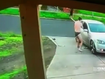 The brave effort was captured on CCTV as the tradie tried to get the alleged car thief out of his vehicle.