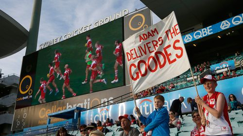 Swans fans hold a banner in support of Adam Goodes. (AAP)
