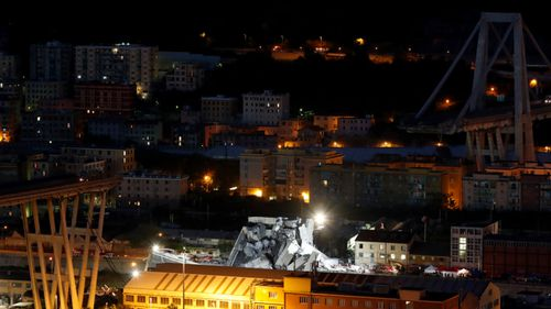 Italian emergency workers are continuing the search of the Genoa bridge disaster site through the night after at least 26 people were killed when it collapsed.