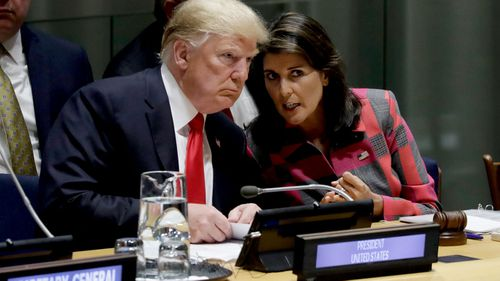 President Donald Trump talks to Nikki Haley at the United Nations General Assembly.