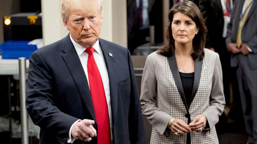 President Donald Trump addresses the media as he arrives with Nikki Haley, the US ambassador to the UN, during the 73rd session of the United Nations General Assembly.