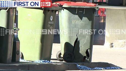 One of the homemade devices was found in one of these bins. (9NEWS)